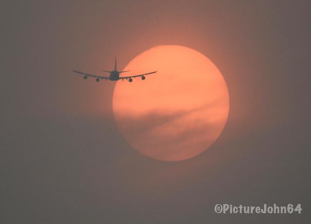 Air Bridge Cargo Boeing 747 (VQ-BHE) crossing an orange colored sun at sunset