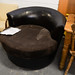 Brown fabric and leatherette love seat E120