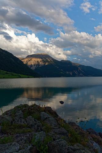 italy italia sunset lake reschensee lagodiresia water mountain südtirol reflection sky clouds rocks landscape