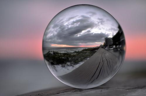 crystal destin orb ball clear reflection refraction sunset illusion rotate 180degrees nikon d810 70200 quartz beach pastel bokeh stormy windowsspotlight