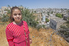 Attivat, 13, attends a Palestinian school called Qurtoba in the heart of the Israeli-controlled H2 area of Hebron.  To get there every morning, Attivat, her classmates and teachers must navigate a maze of checkpoints and are often harassed by settlers in the area.   © Peter Biro/EU/ECHO.