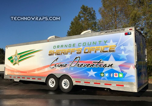 Printed vinyl trailer wrap in Orlando by TechnoWraps.com
