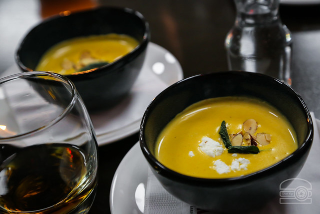 Butternut Bisque w/ Goat Fromage, Crispy Sage served with Woodford Reserve Distiller Select