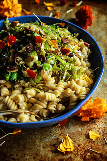 Creamy Butternut Squash Pasta with Shredded Brussles Sprouts, Bacon and Raisins | by Heather Christo