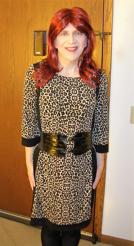 Leopard print dress, red hair, and belt