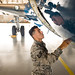 Tech Sgt. Jessie Sosa, a Special Air Missions Crew Chief with the 89th MXG/MXMA, performs a preflight check on the C-40 used to transport government officials and dignitaries at Joint Base Andrews, Md., Oct. 10, 2017. Long flight hours and loading heavy bags and gear onto the aircraft, in addition to long flights, have led Sosa to use Battlefield Acupuncture to treat his lower back pain. The treatment allows him to avoid the use of pain medications which would necessitate his removal from operational flight status. (U.S. Air Force photo by J.M. Eddins Jr.)