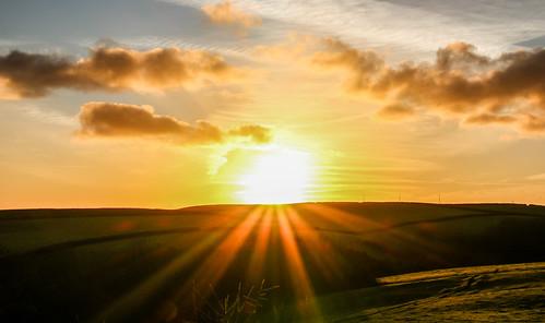 andygocher canon100d canon100dsigma18250 europe uk wales westwales southwales pembrokeshire coastalpath sunrise landscape sun flare clouds cloudscape sunburst
