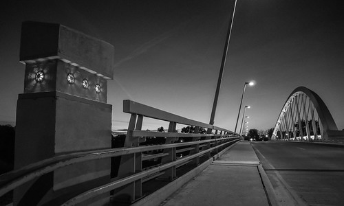main street bridge scioto mile downtown columbus ohio urban city architecture black white bw monochrome twilight dusk evening sunset sky lights empty dark olympus omd em10mkii panasonic 1232mm leading lines vanishing point inclined arch suspension contemporary modern design