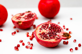 Pomegranata on a White Background Close-up   by wuestenigel