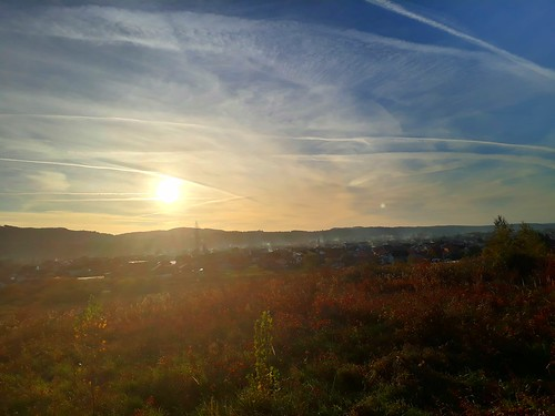 autumn day allsaintsday sun sunset petrinja croatia orthodox blue sky white clouds vapour trails panorama landscape town village croatian eu europe european balkan balkans hrvatska houses smoke mist haze outdoor outside field nature natural rural scene green wild grass shrubs plants vegetation