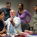 Former Air Force Colonel, Dr. Stephen Burns demonstrates the application of a Battlefield Acupuncture needle to nurse practitioner Melanie Medina, Navy Hospital Corpsman Logan Badders and registered nurses Sylvia L Brooks and Air Force 1st Lt. Folake Niniola during a Battlefield Acupuncture training session at the Air Force Acupuncture Center at the Malcolm Grow Medical Clinic, Joint Base Andrews, Md., Jun. 21, 2017. (U.S. Air Force photo by J.M. Eddins Jr.)