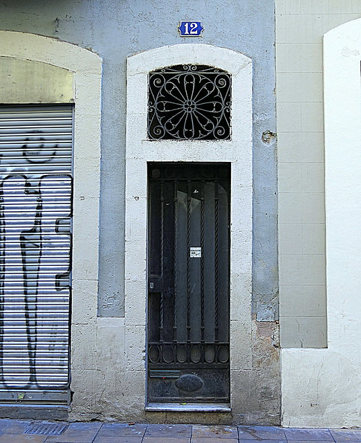 A narrow doorway with an iron