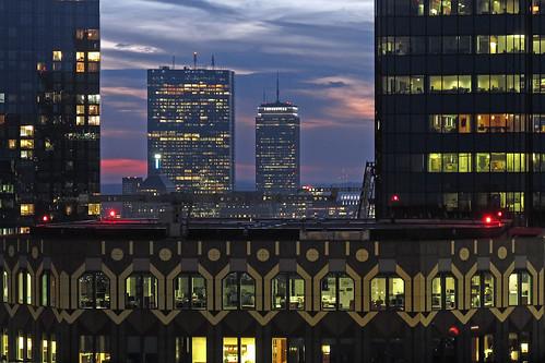 prudentialandhancockthroughtthe skyscrapermaze sunsetdowntownboston officemazewindowtothesky bostonmafromthetopofcustomhouse