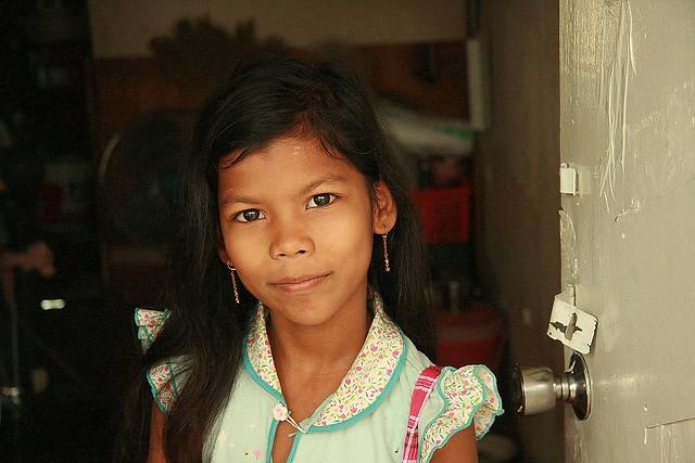 rohingya girl in a doorway