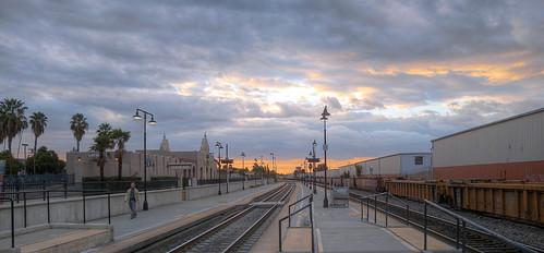 sunrise glendale gatewaytransitcenter trainstation platform tracks railroad railway sky clouds panorama