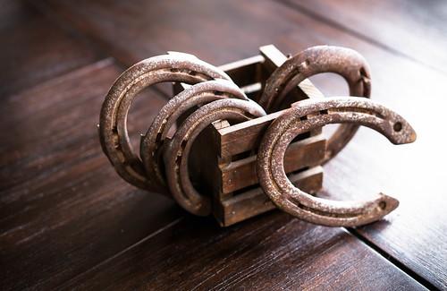 Old horseshoes on wooden box | by wuestenigel