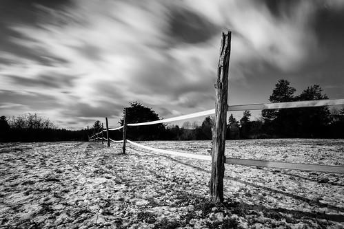 blackandwhite longexposure cloudmovement fence farm snow newyork landscape dramatic bw outdoor