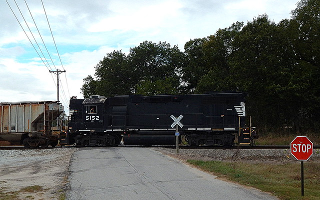 CKIN with ex NS high hood crossing c.r.1475 near Hanna Indiana