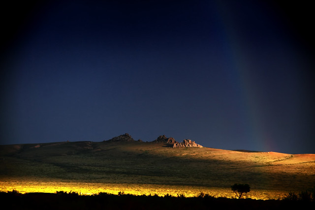 A Rainbow Touches The Mongolian Plains At Sunset