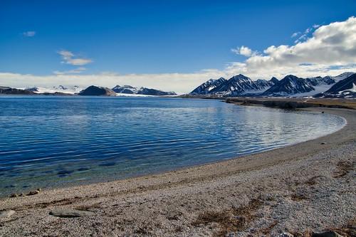 mountains glaciers snow ice water sky arctic svalbard spitsbergen norway
