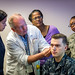 Former Air Force Colonel, Dr. Stephen Burns demonstrates the application of a Battlefield Acupuncture needle on the ear of Navy Hospital Corpsman Logan Badders as nurse practitioner Melanie Medina and registered nurses Sylvia L Brooks and Air Force 1st Lt. Folake Niniola observe during a Battlefield Acupuncture training session at the Air Force Acupuncture Center at the Malcolm Grow Medical Clinic, Joint Base Andrews, Md., Jun. 21, 2017. (U.S. Air Force photo by J.M. Eddins Jr.)