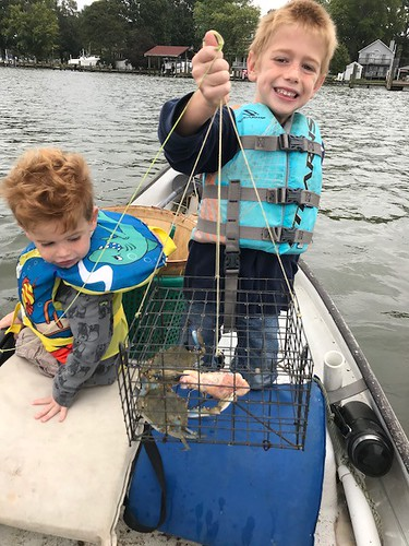Photo of two boys with their catch of crabs