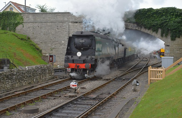 Southern Railways Battle of Britain Class Pacific Loco No.34070 'Manston' makes a spirited departure from Swanage, with a service to Norden. Swanage Railway. 22 07 2017