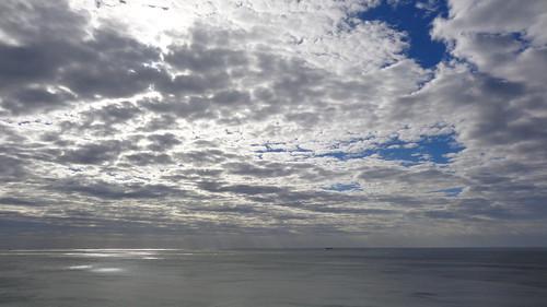 sunlight through cloudy ocean sunlightthroughacloudyocean durban southafrica south africa kwazulunatal clouds cloudysky cloud cloudyocean sea water sun coast coastline coastal sky