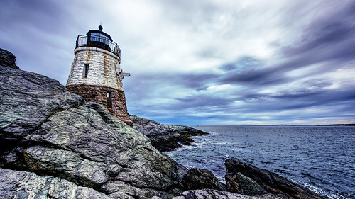 lighthouse architecture building castlehill newport rhodeisland storm narragansettbay rocks rocky ocean sea bay beach sky clouds seascape
