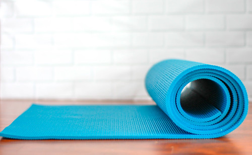 Roll-Up Yoga Mat on a White Background | by wuestenigel
