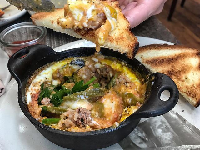 Coddled Egg, Chicken Pork Boudin, Tomato Cornmeal Gravy, Pickled Okra ($14)