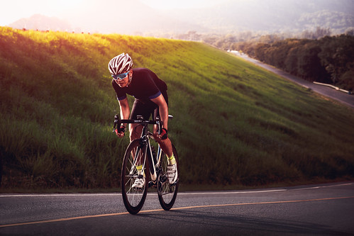 action adult adventure asian asphalt athlete background bicycle bicyclist bike biker biking competition concept cycle cycling cyclist downhill effort exercise extreme fast fit fitness healthy helmet hobby leisure lifestyle male man motion nature outdoor people person portrait race racer racing ride rider riding road sky speed sport sports street summer sunglasses sunset tour track triathlon white young tambonbangphra changwatchonburi thailand th
