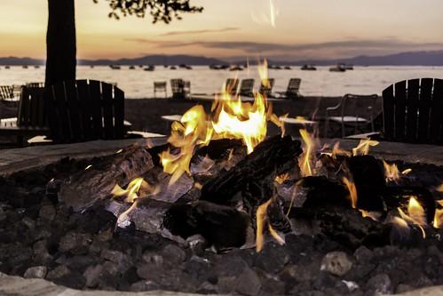 firepit laketahoe southlaketahoe rocks flames fire burning tree chairs alpione lake mountain sunset sunsetlake boats inyonationalforest sierranevada california joelach