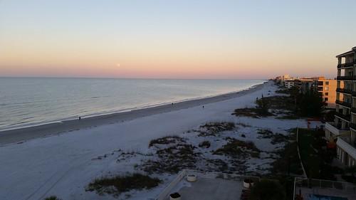 lunar eclipse moon sky beach sand surf water waves sunrise landscape madeirabeach treasureisland florida lovefl gulf gulfofmexico beachresort commodorebeachclub horizon clouds penumbral fullmoon dunes sanddunes solar
