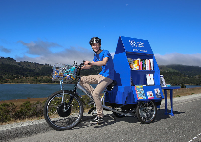 Intern riding one of our Book Bikes.