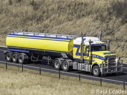 nswbw72wl macktrident rledwardssonsbulkhaulage westlinkm7motorway elizabethhillsnsw olympus australia nsw newsouthwales vehicle truck australianroadtransport roadtransport road haulage australiantrucks aussietrucks roadfreight primemover lorry tankertruck yellow