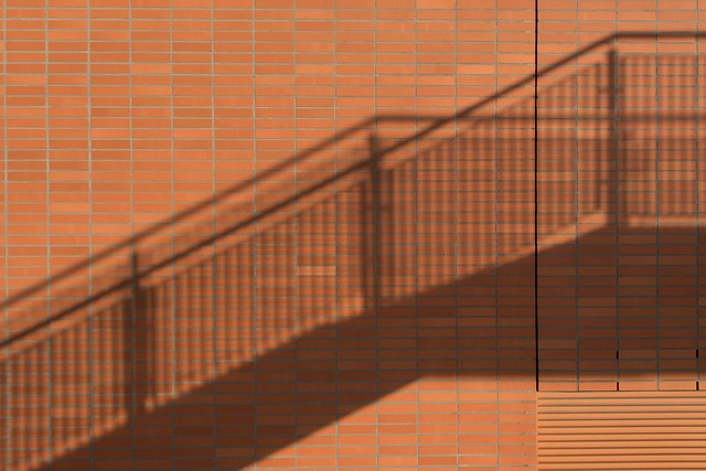 Shadows of a stair on a brown wall