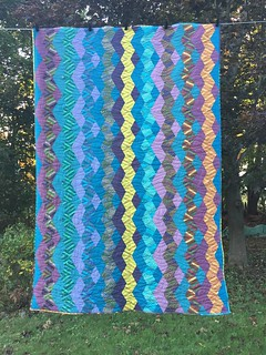 Boomerang by Jaybird quilts using Kaffe Fassett fat quarters.