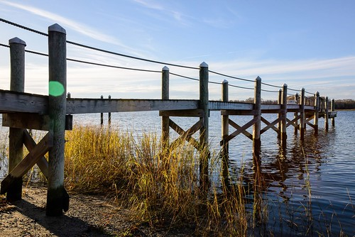 d610 tamron28300xrdiif barrington rhodeisland reeds dock viewnx2 cacorrection river water cameracorrectionfilter viveza sunset flare