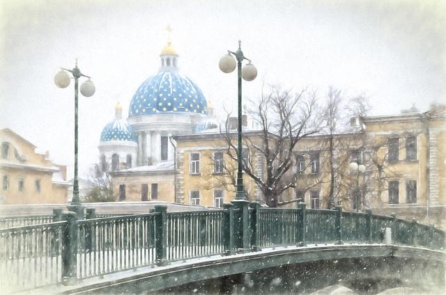 The Krasnoarmeysky bridge and The Trinity Cathedral under snowstorm.