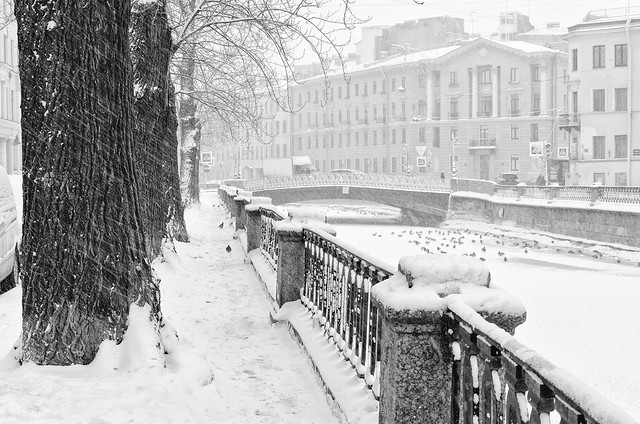 The Griboyedov canal embankment under strong snowstorm. B/w image.