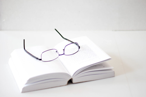 Book with Eyeglasses on a White Background | by wuestenigel