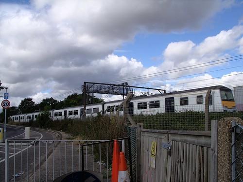ABELLIO EAST ANGLIA ELECTRIC TRAIN TRAVELLING THROUGH AN EAST LONDON BOROUGH SUBURB STREET ENGLAND 30-9-2016 SS854797