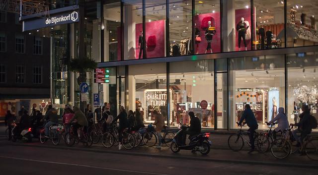 Cyclists by the Bijenkorf