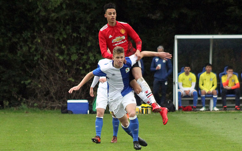 Millen Baars uses Blackburn's Ben Paton to rise highest