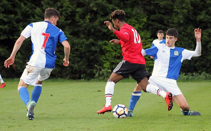 Angel Gomes is dispossessed by John Buckley