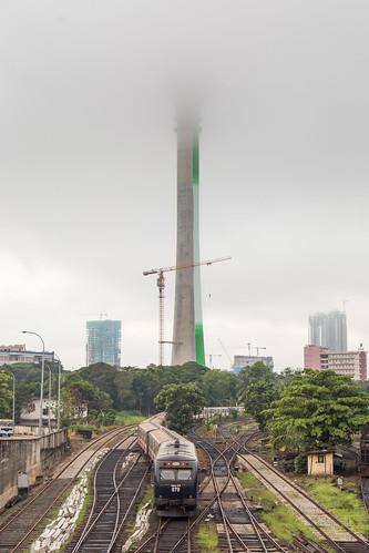 colombo srilanka train track railway maradana lotus tower nelum s10 locomotive dmu mist morning cloud