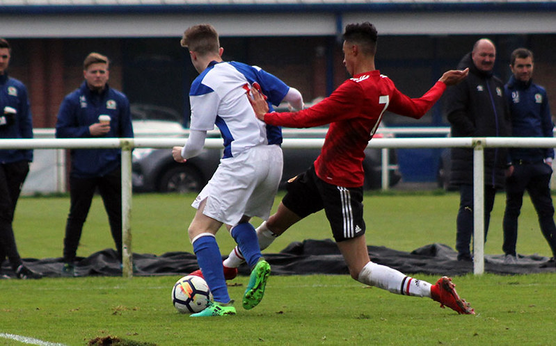 Bradley Lynch attempts to take the ball past Millen Baars
