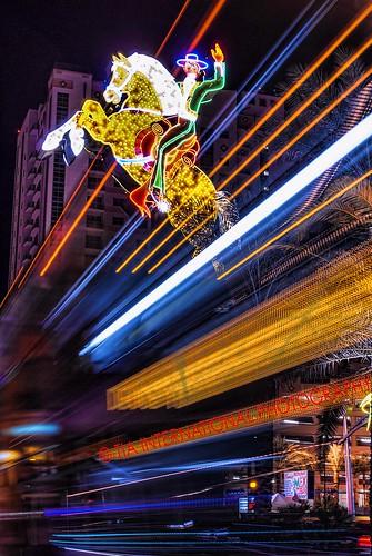 lasvegas las vegas boulevard blvd lv nevada downtown neon sign cowboy horse urban landscape street scene entertainment center centre travel tourism casino long exposure light trails streams motion blur ranger bus night tia tosinarasi ©tiainternationalphotography americana oldwest vegasstrong