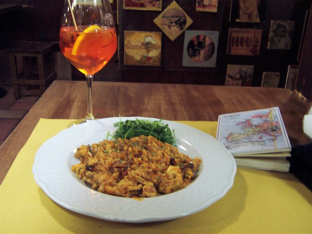 Seafood risotto, with a glass of Spritz
